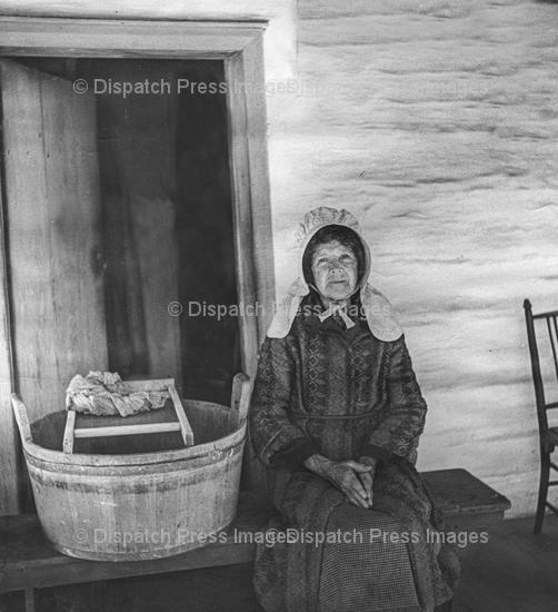 Amish Woman With A Washtub