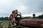 Boy and Girl on a Tractor