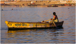 Woman Rowing Along the Ganges River