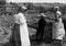 Mennonites in Their Garden