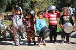 Palestinian Children Carry Pots and Gather in Front of the Home of Volunteer Palestinian Chef Amal Abu Amra