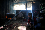 Palestinian Volunteer Amal Abu Amra Food on Firewood Inside Her Home Before distributing it to children and Poor Families