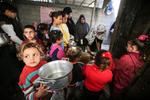 Amal Abu Amra Prepares Food for Needy Families East of Gaza City
